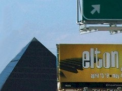 On an I-15 North billboard in Las Vegas, Nevada, Elton's piano keys sprout like wings from the Luxor Hotel, behind - Click for larger image (http://jamesmcgillis.com)