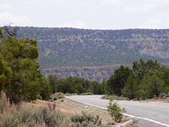 "From U.S. Highway 160, the ""Peabody Coal Company Access Road, also known as Indian Route 41 climbs the side of Black Mesa - Click for larger image (http://jamesmcgillis.com)"