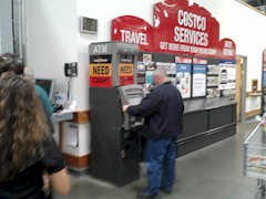 A technician opens the front panel of a CardTronics NCR EasyPoint freestanding kiosk ATM at a Costco warehouse - Click for larger image (http://jamesmcgillis.com)