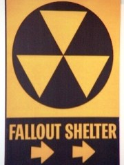A 1950's fallout shelter sign warns of potential for nuclear disaster - Click for larger image (http://jamesmcgillis.com)