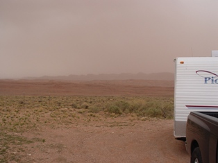 Dust storm obscures view of Comb Ridge, Utah - Click for larger image (http://jamesmcgillis.com)