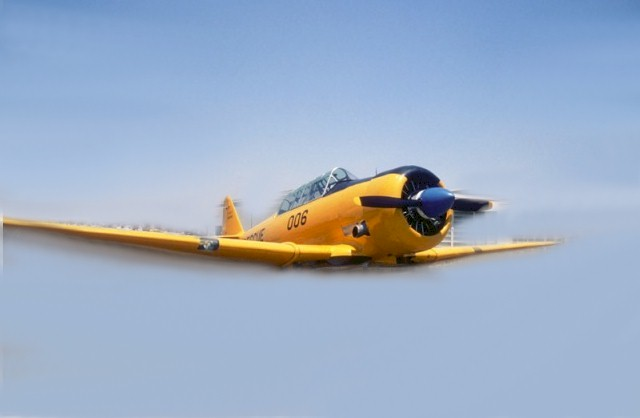 Veteran of World War II, a Condor Squadron North American AT-6/SNJ vintage aircraft - Click for Memorial Day flyover image (http://jamesmcgillis.com)