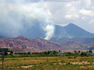 Wild fire on the slopes below the La Sal Mountains - Click for larger image (http://jamesmcgillis.com)