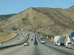 After a steep uphill grade, Interstate I-5 North swoops along, near Pyramid Lake, heading toward the Grapevine and Bakersfield, California - Click for larger image (http://jamesmcgillis.com)