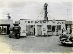 The original Crescent Junction Cafe and gas station under partial demolition in 1955. The new building is under construction in the background - Click for larger image (http://jamesmcgillis.com)