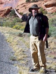 Author Craig Childs points the way to Seven Mile Canyon, Moab, Utah - Click for larger image (http://jamesmcgillis.com)
