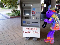 Ancient Spirit Kokopelli removing the old Automated Teller Machine (ATM) - Click for larger image (https://jamesmcgillis.com)