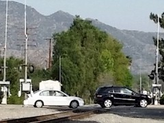 In Simi Valley, California, motorists show a casual attitude toward safety as they stop on the Union Pacific Coast Line railroad tracks - Click for larger image (https://jamesmcgillis.com)