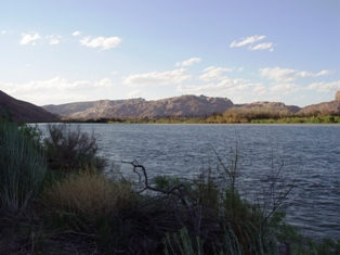 The Colorado River, running wide and blue in late afternoon, at the Portal, Moab, Utah - Click for larger image (http://jamesmcgillis.com)