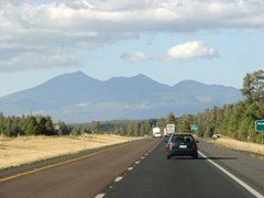 The San Francisco Peaks, from Interstate I-17, traveling north towards Flagstaff, AZ - Click for larger image (http://jamesmcgillis.com)