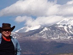 The author, Jim McGillis at Behind the Rocks, with the La Sal Range in the background - Click for larger image (http://jamesmcgillis.com)