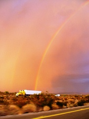 Thunderstorm and rainbow enlighten a Peterbilt tractor-trailer rig on Interstate I-10 in the Tonopah Desert, Arizona - Click for larger image (http://jamesmcgillis.com)