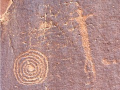 An ancient dancer opens her arms to the spiral of infinity - petroglyph at Seven Mile Canyon, Moab, Utah - Click for larger image (http://jamesmcgillis.com)