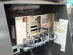 Inside the NCR EasyPoint ATM cabinet is an IBM PC chassis, featuring an x86 processor, obsolete IBM OS/2 operating system, a telephone line and various data cables - Click for larger image (http://jamesmcgillis.com)