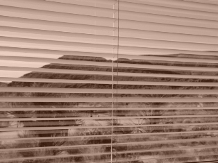 Stacked slats create a horizontal shutter effect - Click for holographic image of a teapot, hidden within the graphic (https://jamesmcgillis.com)