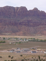 The Pueblo Verde tract in the Spanish Valley, with the Moab Rim, beyond - Click for larger image (http://jamesmcgillis.com)