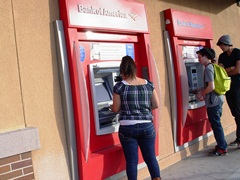Customers conduct business at an outdoor, exterior ATM that has no crash barriers or other protection - Click for larger image (http://jamesmcgillis.com)