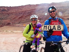 A couple participating in the 2012 Moab Xstream Adventure Race pose with Kokopelli in new energy light, on the Potash Road - Click for larger image (http://jamesmcgillis.com)