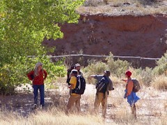 Our Confluence 2008 writing group stops for a rest near a mysterious rail fence in Seven Mile Canyon, Moab, Utah - Click for larger image (http://jamesmcgillis.com)