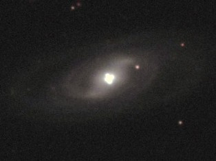 "Celestial Einstein-Lens proves ""negatively curved space"" theory. - Click for larger image (http://jamesmcgillis.com)"