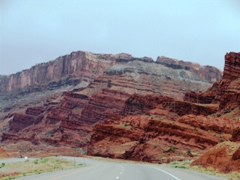 U.S. Highway 191 South, where the Moab Fault (foreground) and the Moab Rim (background) intersect - Click for larger image (http://jamesmcgillis.com)
