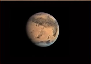 """The """"Cute little face on Mars"""", looking back at us. - Click for larger image. (https://jamesmcgillis.com)"""