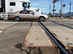 Path of the derailed cab-control car No. 645 across the concrete grade crossing at Rice Ave. in Oxnard is clearly evident in this picture - Click for larger image (https://jamesmcgillis.com)