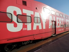 """Stay Alert, Stay Alive"" graphic emblazoned on an obsolete Metrolink Bombardier bi-level coach car, at Los Angeles Union Station in early 2015 - Click for larger image (https://jamesmcgillis.com)"