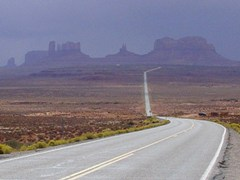 View south toward Monument Valley, Utah landforms, with storm clouds approaching - Click for larger image (http://jamesmcgillis.com)