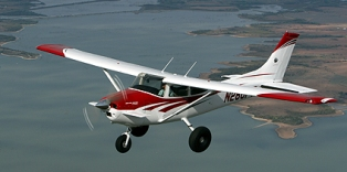 A Cessna 182 King Katmai 300 SE/STOL aircraft in flight - Click for larger image (http://jamesmcgillis.com)