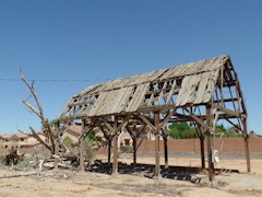 As seen in 2014, the old pole barn in Mesquite, Nevada that once was a thriving Ranch Market deteriorates into the desert sands - Click for larger image (http://jamesmcgillis.com)