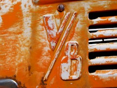V8 badge embossed into the hood of an old Ford dumptruck in Holbrook, AZ - Click for larger image (http://jamesmcgillis.com)