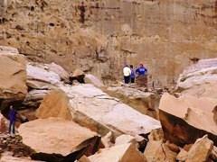 Visitors walk the rock-fall trail at Pueblo Bonito, Chaco Canyon, NM - Click for larger image (https://jamesmcgillis.com)