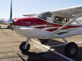 The Cessna 182 Katmai 300 at rest, Moab Airport, Moab, Utah.  Note white lifting canard extending from the engine cowling - Click for larger image (http://jamesmcgillis.com)