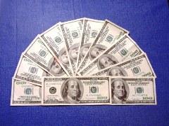 Eleven $100 bills, arranged as a fan - Click for larger image (https://jamesmcgillis.com)