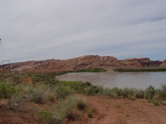 In May 2011, flooding along the Colorado River at Moab breached a low-lying section of nuclear and hazardous waste at the Moab Pile -  Click for larger image (https://jamesmcgillis.com)