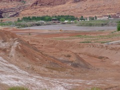 In May 2011, the Colorado River is shown near the top of its banks at the Moab Pile. Within days, much of the flat area in this picture was inundated by floodwater - Click for larger image (http://jamesmcgillis.com)