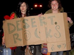 These two hitchhikers are credited with inventing the website name 'Desert.Rocks' at the festival in 2011 - Click for larger image (http://jamesmcgillis.com)