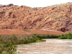 In May 2011, flood waters lapped at the bottom of the Moab UMTRA Superfund site, destroying a new riverside bicycle path - Click for larger image (http://jamesmcgillis.com)