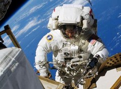 Astronaut on a spacewalk, outside the International Space Station - Click for larger image (http://jamesmcgillis.com)