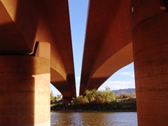 Passing between the dual arches of the energy bridge, on the Colorado River, North Portal, Moab, Utah - Click for larger image (http://jamesmcgillis.com)