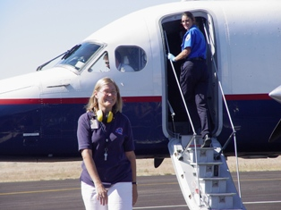 At Moab Airport, Great Lakes Airlines Agent Tiger Keogh completes her field duties as TSA agent boards plane for routine search - Click for larger image (http://jamesmcgillis.com)