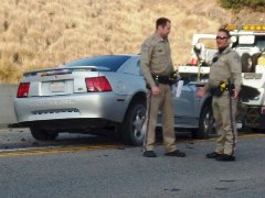 Two CHP officers discuss the high-speed wreck of a 2002 Mustang GT into the center divider of Highway 118 near Topanga Canyon - Click for alternate image of the wreck - (http://jamesmcgillis.com)