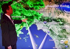 Local TV meteorologist points to Doppler radar image of storm clouds over Simi Valley, California - Click for larger image (http://jamesmcgillis.com)