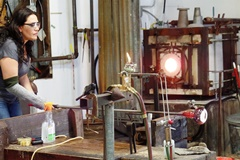 An artist works with molten glass at the Harmony Glassworks, in Harmony, California - Click for larger image (https://jamesmcgillis.com)