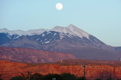 At dusk, a full moon rises over the snow-capped peaks of the La Sal Range at Moab, Utah, May 2014 - Click for larger image (http://jamesmcgillis.com)