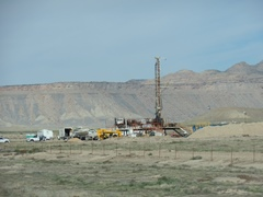 In 2014, a new gas well drilling rig sprang up adjacent to U.S. Highway 191, north of Moab and in sight of the Book Cliffs - Click for larger image (http://jamesmcgillis.com)