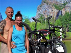 At the Moab Rim Campark a young couple poses in front of an RV graphic depicting the Yosemite Valley - Click for larger image (http://jamesmcgillis.com)