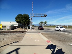 Looking back to where the driver of a work truck turned his rig on to the railroad tracks at Rice Ave. and Fifth St. in Oxnard, California, directional and safety markings are almost non-existent - Click for larger image (http://jamesmcgillis.com)