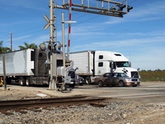 At the Rice Ave. grade crossing, big rigs and automobiles wait at the location where Jose Sanchez Ramirez erroneously turned his Ford F-450 work truck on to the railroad tracks - Click for larger image (https://jamesmcgillis.com)